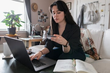 Woman using credit card online shopping